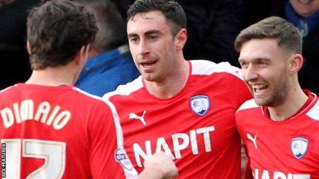 Lee Novak (centre) celebrates his Chesterfield goal