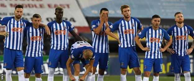 Kilmarnock players are left dejected by the penalty shoot-out