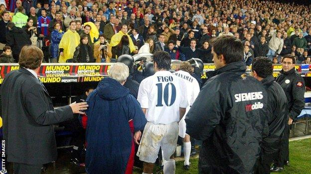 Figo leaves the pitch at full-time