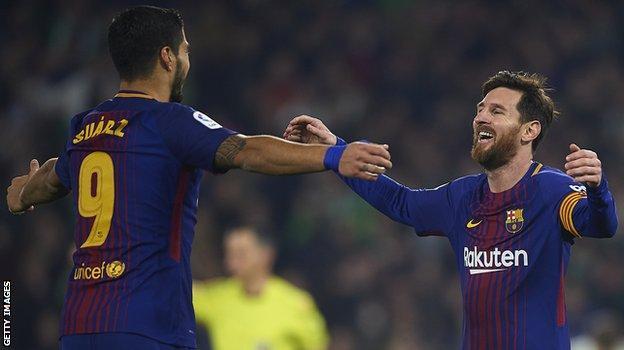 Lionel Messi and Luis Suarez of Barcelona