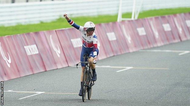 Sarah Storey celebrates after crossing the line