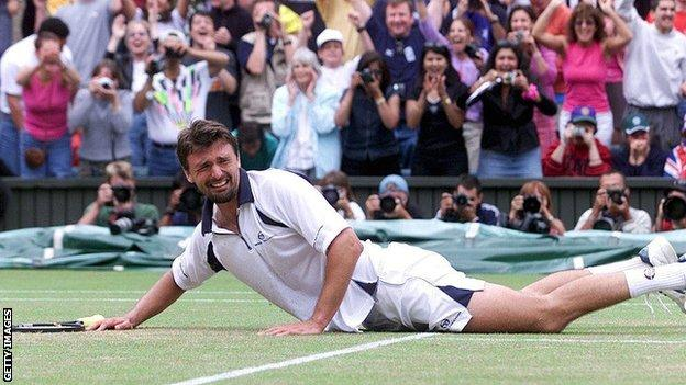 A tearful Goran Ivanisevic falls to the Wimbledon grass in celebration after beating Pat Rafter