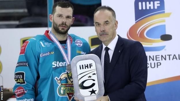 Belfast Giants team captain Blair Riley accepts the silver trophy from Continental Cup tournament chairman Igor Nemecekto