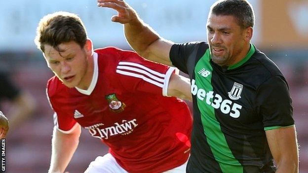 Connor Jennings (left) in action against Stoke City's Jon Walters