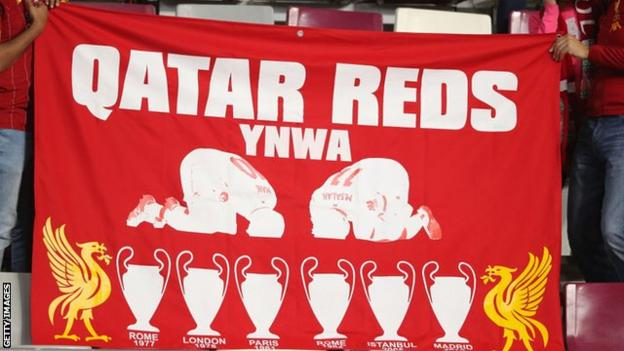 Liverpool fans with a banner in Qatar