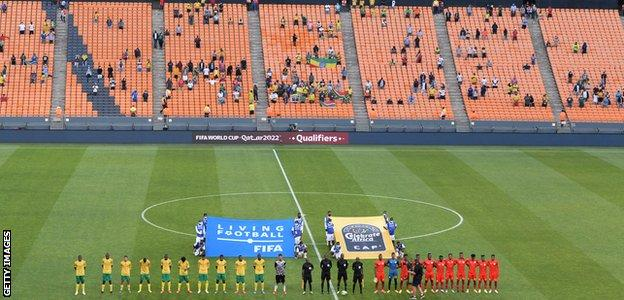 South Africa and Ethiopia line up ahead of their World Cup qualifier at the FNB Stadium