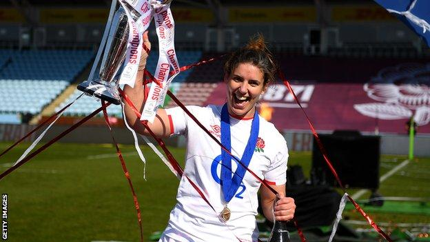 England rugby captain Sarah Hunter celebrates as she holds up the 2021 Women's Six Nations trophy