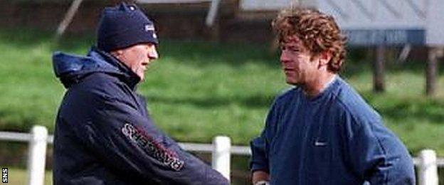 Andy Goram (right) chats to his former Rangers boss Walter Smith in the 1997-98 season