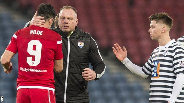 Connah's Quay Nomads manager Andy Morrison celebrates after the win over Queen's Park