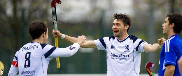 Scotland's Chris Grassick and forward Kenny Bain