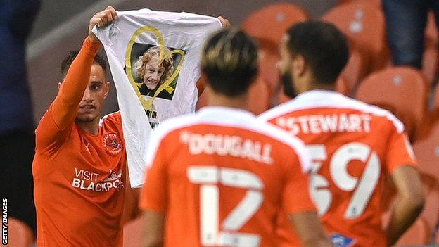 After scoring Blackpool's third goal, Jerry Yates held up a t-shirt commemorating nine-year-old Blackpool boy Jordan Banks who was killed after being struck by lightning