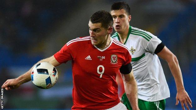 Northern Ireland's Paddy McNair shadows Sam Vokes in Thursday's friendly in Cardiff