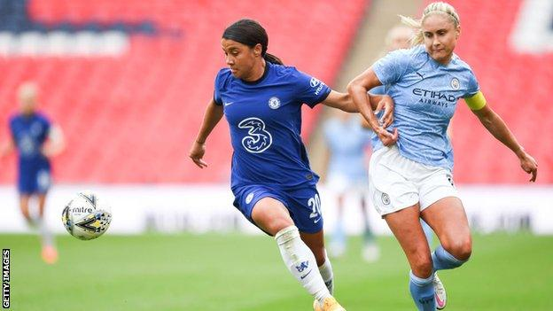 Chelsea's Sam Kerr battles for possession with Manchester City's Steph Houghton during the Women's Community Shield