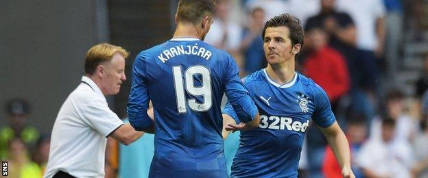Joey Barton shakes hands with Niko Kranjcar as he comes on for his debut