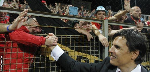 Chris Coleman celebrates with Wales fans