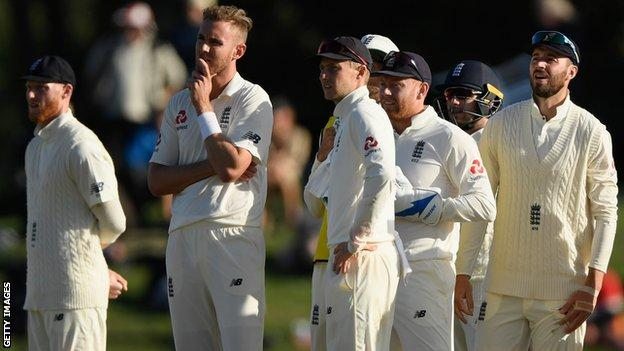 Stuart Broad (second left) and England watch a review on the big screen