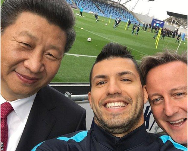 Manchester City's Sergio Aguero with China President Xi and British Prime Minister David Cameron during during the China leader's state visit in October 2015