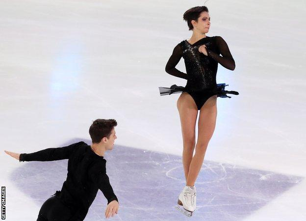 Natalya Zabiyako and Alexander Enbert perform a throw in the pairs