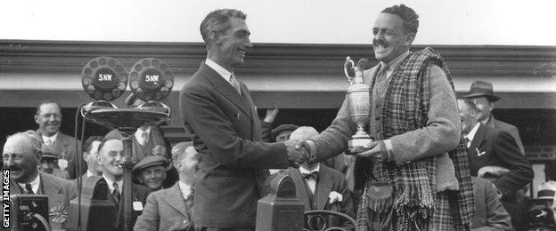 Tommy Armour receives the Claret Jug after winning the 1931 Open Championship