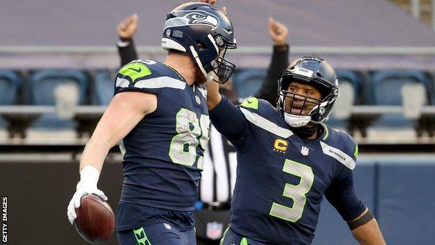 Will Dissly of the Seattle Seahawks celebrates with Russell Wilson after scoring a 10 yard touchdown against the New York Jets
