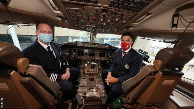 Conor Murray sits alongside a plane captain in the cockpit