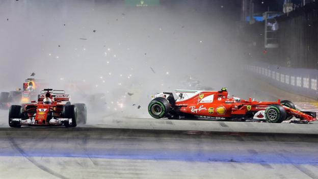 Sebastian Vettel collides with Kimi Raikkonen and Max Verstappen on the first bend during the Singapore Grand Prix