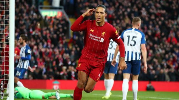 Liverpool defender Virgil van Dijk celebrates scoring against Brighton