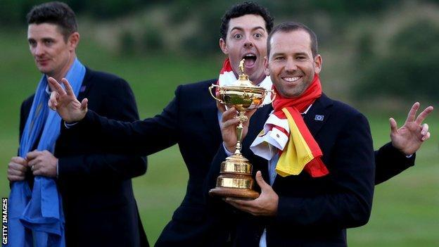 Sergio Garcia holds the Ryder Cup trophy in 2014, alongside Rory McIlroy and Justin Rose
