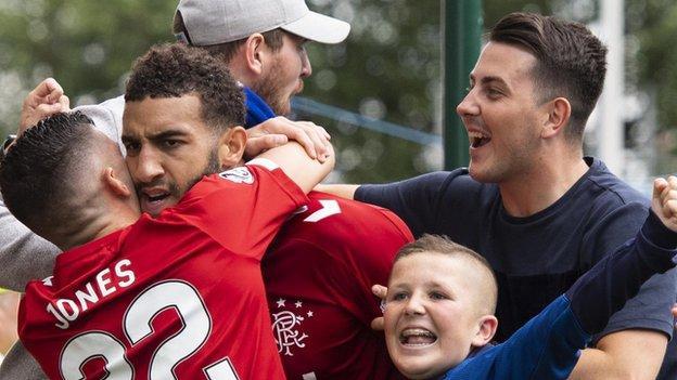 Connor Goldson celebrates with Rangers fans