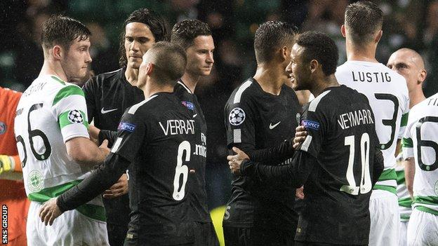 Celtic's Anthony Ralston (56) exchanges words with Neymar at full-time