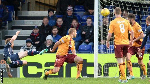 Craig Curran fires a shot into the top corner of the net