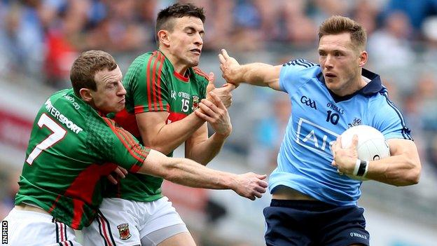 Dublin's Paul Flynn attempts to fend off Colm Boyle and Jason Doherty