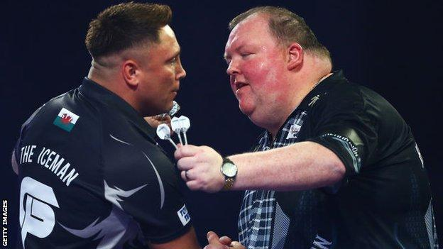 John Henderson (right) congratulates Gerwyn Price after his 4-0 defeat