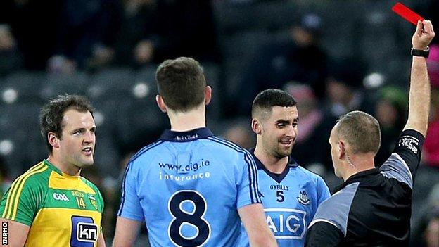 Referee Conor Lane issues a red card to Dublin's James McCarthy in Saturday's game at Croke Park