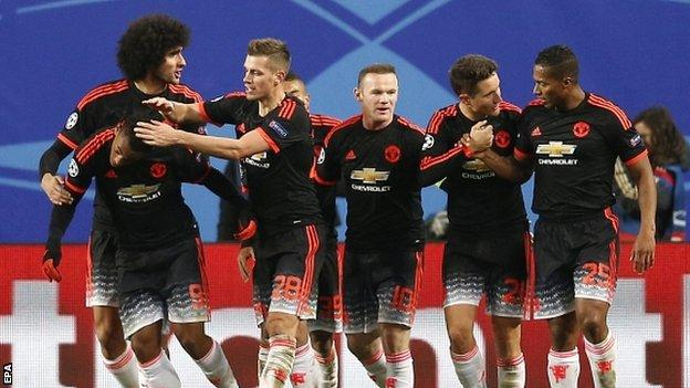 Manchester United celebrate the strike of Anthony Martial (far left)