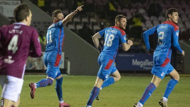 Inverness' Shane Sutherland (centre) celebrates making it 1-1