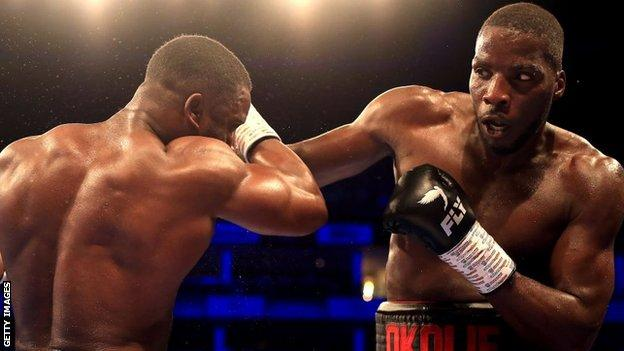 Okolie (right) has 14 wins from 14 bouts