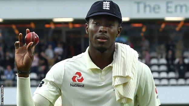 England fast bowler Jofra Archer holds up the ball to the crowd as he walks off after taking 6-45 against Australia