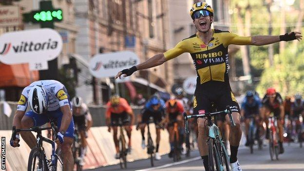 Wout van Aert (right) holds his hands out in celebration after beating Julian Alaphilippe (left) to win the 2020 Milan San-Remo