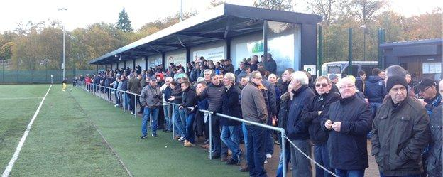 Fans line the pitch as East Kilbride face Forres Mechanics at K Park.