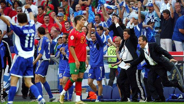 Greece celebrate beating Portugal as Cristiano Ronaldo looks on