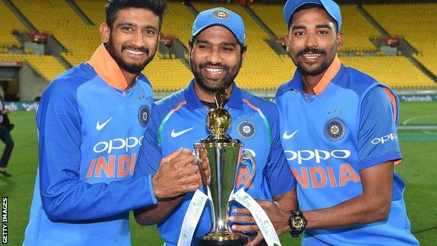 Khaleel Ahmed, Rohit Sharma and Mohammad Siraj with the ODI series trophy