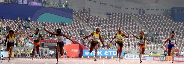 The women's 100m final at the World Championships takes place with a sparse crowd at the Khalifa International Stadium