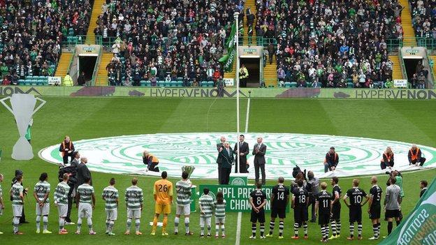 Celtic unfurl the Scottish Premiership flag at the start of season 2014-15
