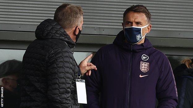England manager Phil Neville watches a Women's Super League game