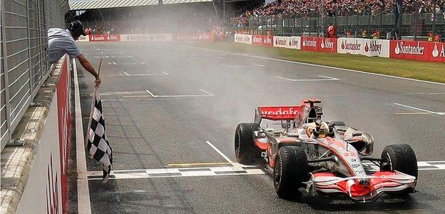 Lewis Hamilton crosses the finish line to win the 2008 British Grand Prix