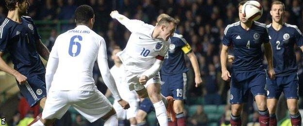 Wayne Rooney scores with a header against Scotland at Celtic Park