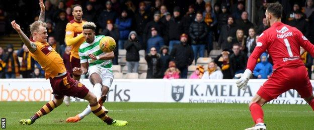 Celtic's Scott Sinclair has a shot saved by Motherwell's Trevor Carson
