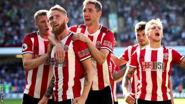 Oliver McBurnie (second left) celebrates scoring for Sheffield United