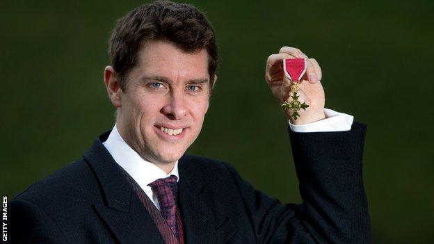 Paul Hawkins poses with his OBE